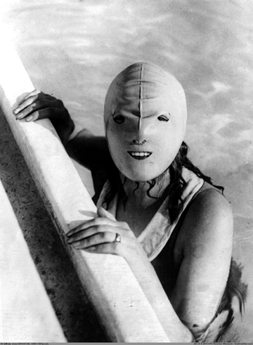 Girl bather in swimming mask