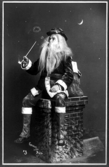 Santa taking a break on a chimney