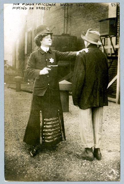 woman policeman with criminal