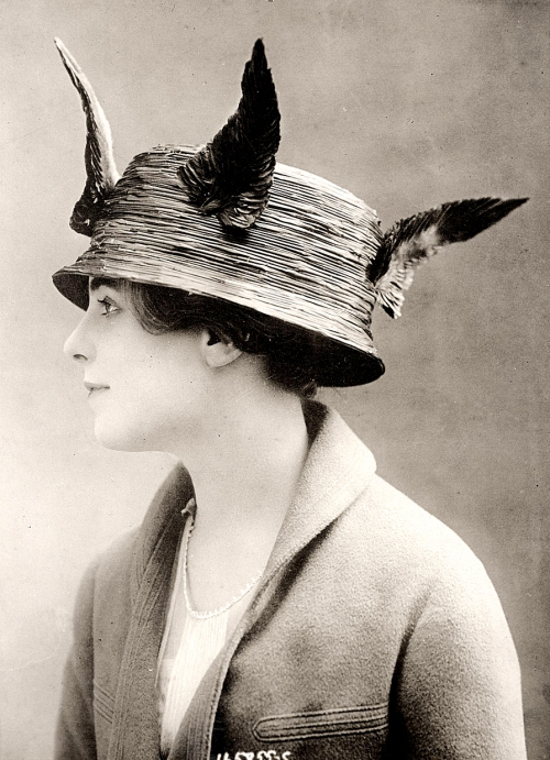 A woman in a feathered hat